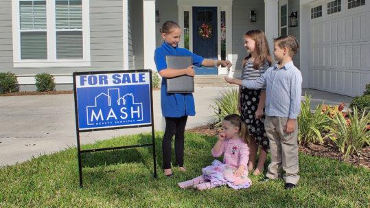 Kids selling real estate.