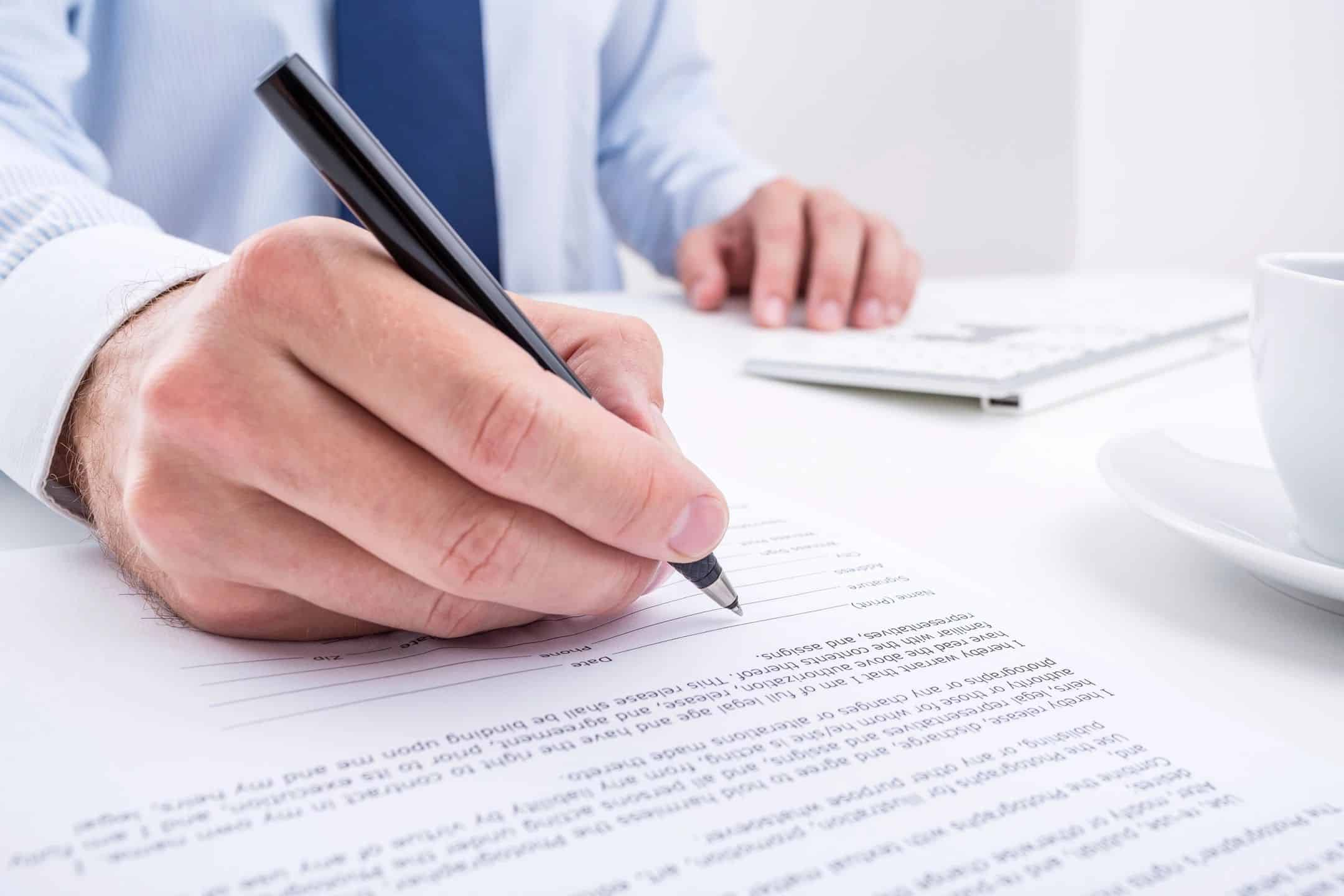 Buyer signing a contract